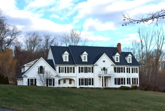 This 1995-built Colonial at 75 Beacon Hill Lane stands on 2.05 acres, and includes 13 rooms and 7,759 square feet of living space. It sold in December 2014 for $2,390,000. Credit: Michael Dinan