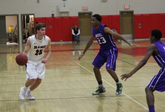 Claude Chandonnet drives past two Westhill defenders. Credit: Terry Dinan