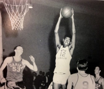 Wilky Gilmore grabbing a rebound in a game when he played at New Canaan HIgh.