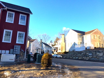Though largely unwanted, the development where Jelliff Mill once stood worked its way through town approvals under threat of going ahead anyway under the state's Affordable Housing Appeals Act. The developers attempted to tie the units to New Canaan's history by giving them prominent town names. No name was listed on an application received Jan. 13, 2015 for a new unit atop what appears to be a 6-bay garage. Credit: Michael Dinan