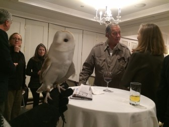Connecticut Audubon brought Milton, a 9-year-old barn owl, to the New Canaan Land Trust annual meeting, held Jan. 22 at the Country Club of New Canaan. In the background here is New Canaan's Jim Fowler, who spoke during the meeting. Credit: Michael Dinan