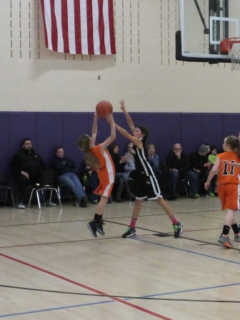 Tyler Towers blocks a shot for New Canaan 6th Grade Basketball. Contributed photo