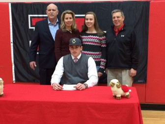 """Zach Allen signs on to play football at Boston College on Feb. 4, 2015, National Letter of Intent signing day. Here he is with parents Irene and Mike, sister Alexandra and coach Lou Marinelli. Asked about how he feels about formally signing, Allen said: """"It's really exciting. It's like a new beginning and it's the next chapter of my life. I'm really excited for the opportunity to play at such a distinguished school like Boston College. I've been here my entire life and I wanted to stay close to home so that my family and friends could see me play, because they've helped me get into this situation where I am today. I woudn't be here without them, so I'm very thankful for everything they've done and really excited to play."""" Credit: Michael Dinan"""
