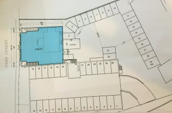 Park Street runs north-south on the left of this site plan, and the long building on the bottom is Mrs. Green's. The blue area represents the footprint of a proposed new structure. Anthony Giordano of Elm Street Partners said Post Office trucks could come off of Pine Street as they always have and back toward a new loading dock as they've been accustomed to doing for some five decades. Specs by Harvey Kaufman Architect PC of New Canaan