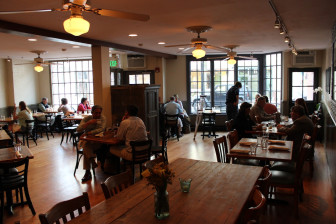 The Farmer's Table has reopened on Forest Street in a larger space with an open kitchen. Credit: Terry Dinan