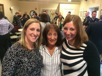 The family of New Canaan Police Department Lt. Stephen W. Wood, deceased, at a March 26, 2015 awards ceremony in the Lapham Community Center, L-R: daughter Kim, wife Pat and daughter Kelly. The Lt. Stephen W. Wood Memorial Officer of the Year Award was established on this day, and its first recipient is NCPD Officer Aaron LaTourette, who also is Kim's husband. Credit: Michael Dinan