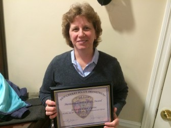 """New Canaan Police Department Sgt. Carol Ogrinc on March 26, 2015 received a Meritorious Police Duty Award. DeMaio said she is """"consistently delivering quality results, dedicated to her job and always giving whatever is necessary to get the job done and go the extra mile for our clients, the people she takes care in her normal course of business. She is our youth officer, our public information officer and our community relations officer. She wears a lot of hats and she does an outstanding job at each one of them."""" Specifically, Ogrinc spearheaded and has been a steward of a critically important program that saw a prescription drugs drop box installed at police headquarters—among other uses, a way to rid medicine cabinets of drugs that often are a lure for criminals as well as a temptation and gateway for young people to opioid addiction. DeMaio said: """"Sgt. Ogrinc was instrumental in getting the program off ground here in New Canaan, and she has really been instrumental in keeping it on track. You think about the things we need to do every day and it requires a lot of effort just to maintain the program and ensure that they stay vital and that is what Sgt. Ogrinc has done for us with this program here. Since its inception, we have taken over 1,270 pounds of prescription medications."""" Credit: Michael Dinan"""