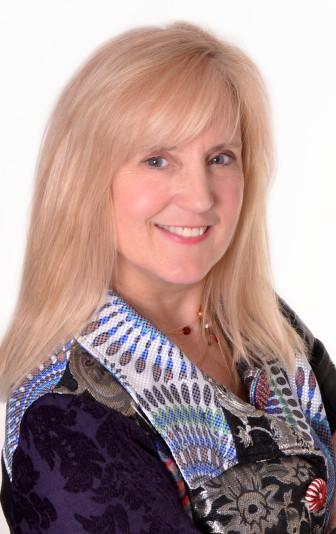 Susan Morrow, a 1972 NCHS grad and owner of SwickPix on Elm Street (www.swickpix.com)