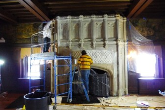 Workers from Jersey City, N.J.-based Zakalak Restoration Arts work on the limestone fireplace at Waveny. Contributed