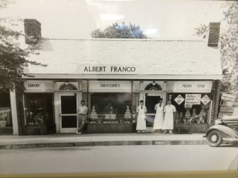 Franco's on Elm Street in the 1930s, certainly after '33 (when Prohibition was repealed). We see Albert Franco at far right, Emo Franco in the white apron on the left of that cluster of three, and Louis Franco leaning in front of the liquor shop. Photo courtesy of the Franco family