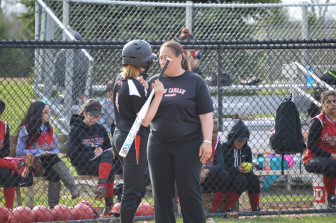 Rams head coach talks strategy with sophomore Bella Marciano as New Canaan defeats Bridgeport Central 13-6 on April 15, 2015. Credit: Terry Dinan