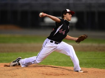 New Canaan senior David Giusti fires in a pitch. Contributed photo