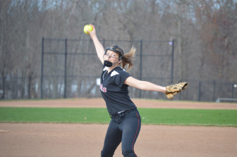 Gillian Kane fires in a pitch as New Canaan defeats Bridgeport Central 13-6 on April 15, 2015. Credit: Terry Dinan