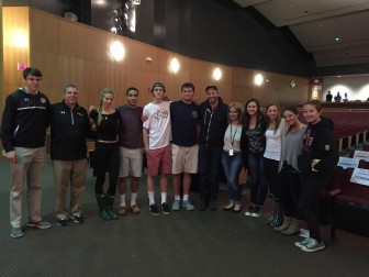 Harry Connick Jr. stands sixth from right in the New Canaan High School auditorium. He supported efforts to raise money for the NCHS Scholarship Fund.