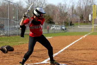 New Canaan's Molly Keshin about to unload a long RBI double as the Rams defeated McMahon 10-0 on Monday, April 13, 2015. Credit: Terry Dinan