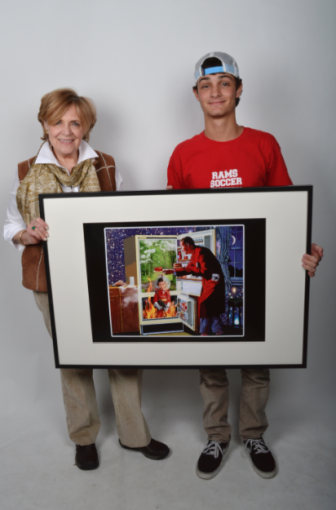 "Art Teacher Jeanne McDonagh and Zach Seger with his art ""Refrigerator."" Contributed"