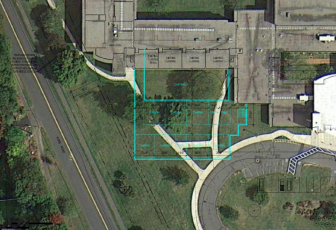 A conceptual drawing that shows about how far an addition at Saxe Middle School may have to bump out of the northwest corner of the structure in order to accommodate proposed new classroom space. Note: This is not a site plan, strictly speaking, but rather a rendering that is based purely on a feasibility study related to instructional space under one proposal now before the Saxe Building Committee and Board of Education. Credit: S/L/A/M Collaborative of Glastonbury