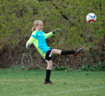 Addie Cannon punts the ball  down field after making a save. Contributed