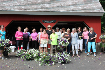 The New Canaan Beautification League put together 160 hanging baskets for the lampposts downtown. On Wednesday, May 13, the town Department of Public Works hangs the arrangements.