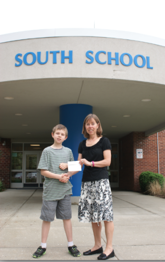 Nate Moor, a 4th grader at South School, with Cynthia Gorey, executive director of the New Canaan Community Foundation.