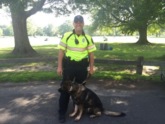 Apollo, New Canaan's new K-9 dog, with Officer David Rivera. Credit: Bella Carpi