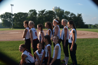 As a show of support for Carolina Welch, the girls had her #22 drawn on their left shoulders in marker, with the Roman numeral X, or 10, for Welch's age, drawn on their right. Credit: Sophia Welch