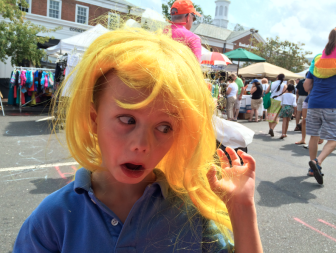Jack Ericson pulls a face at the 2015 Sidewalk Sale in New Canaan, July 18. Credit: Michael Dinan