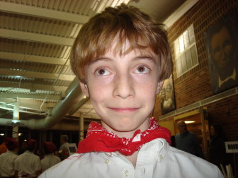 Alex Hutchins as a 5th-grader in 2008, waiting tables at Saxe Pasta Night. contributed