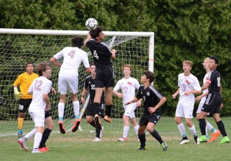 Alex Dolby (#4, white jersey) prepping to connect on a header for the Rams third goal of the afternoon. Credit: Christine Betack