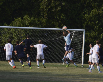 New Canaan High School Rams varsity boys soccer goalie Griffin Paterson makes a save during a scrimmage game on Sept. 8, 2015. Photo by Christine Betack