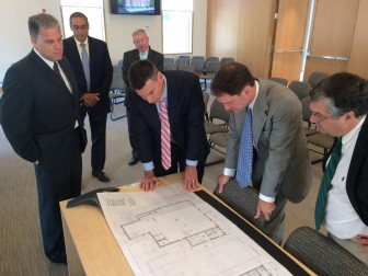 Post Office developer Richard Carratu of LJ18 Properties LLC on the far left, with First Selectman Rob Mallozzi at the far right and U.S. Rep. Jim Himes (D-4) next to him, during a press conference on the future Post Office on Locust Avenue, on Sept. 3, 2015. Credit: Michael Dinan