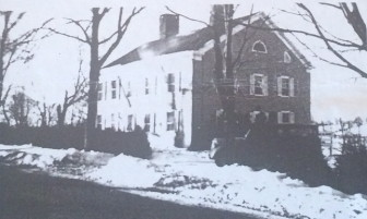 """From the story board: """"Another photograph of the Smith Ridge house, this one shortly after restoration by Dorothy and Addison, probably about 1940 or 1941. Photograph was taken looking to the southwest. The sloping field in the background was where Dan, Sue and David coasted in the winter."""""""