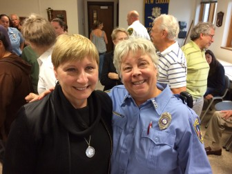 Maryann Kleinschmitt (L) retired from her 15-year career as head of the Animal Control section at the New Canaan Police Department. On Sept. 30, NCPD command staff, officers in the section, town officials, residents and counterparts from area towns gathered for a send-off at police headquarters. Officer Allyson Halm (R) succeeds Kleinschmitt in the role. Credit: Michael Dinan
