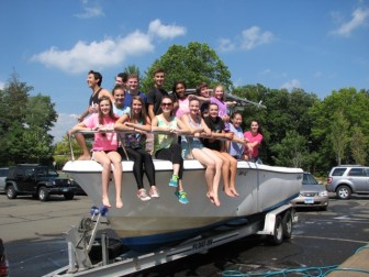 NCHS Theatre Program students washed a boat during a fundraiser on Saturday, Sept. 19, 2015. Contributed