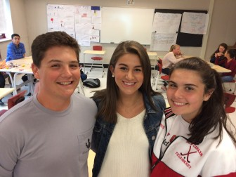 NCHS juniors Andrew Knight, Maggie DeFrancesco and Grace Brown of the Filling In The Blanks Club. Credit: Michael Dinan