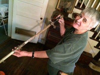 Suzanne Waters, a 1964 NCHS graduate, holds a sword that had belonged to her uncle Patrick Smith. She calls it his Knights Templar sword. Credit: Michael Dinan