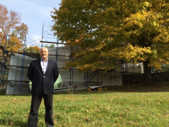 Philip Johnson Glass House Executive Director Greg Sages stands before the Sculpture Gallery, a 1970 structure that should come back online for the 2016 tour season. Credit: Michael Dinan
