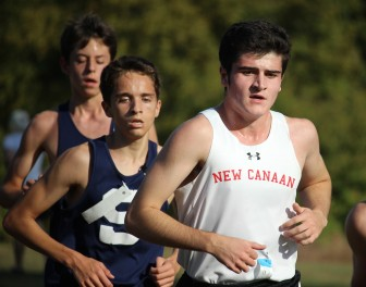 New Canaan junior Michael St. George was the Rams top finisher in the boys race. Credit: Terry Dinan