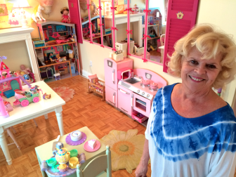 'Let's Dress Up' owner Judy Famigletti in her shop on Cherry Street in New Canaan. It is closing at the end of October after six years, as Famigletti retires from the store. Credit: Michael Dinan