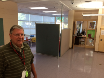 Saxe Middle School Principal Greg Macedo stands near a hallway alcove that's been converted into a Special Ed instruction area due to a shortage of space. Credit: Michael Dinan