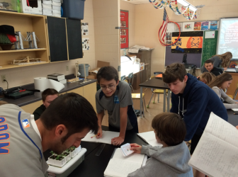 """It's a tight fit,"" 8th grade science teacher Chris Antal says of his undersized classroom at Saxe, originally designed to serve a far smaller group of Special Ed students. Credit: Michael Dinan"