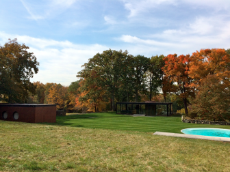 The Brick House, left, is the co-dependent opposite of the famous Philip Johnson Glass House, across the lawn on this National Trust for Historic Preservation site. The site's executive director, Greg Sages, said the building needs to be sealed, stabilized and significant interior work finished. Credit: Michael Dinan