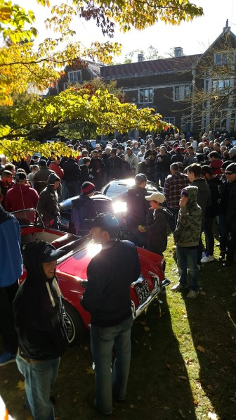 Spectators gather around a Pagani as the Italian-made vehicle exits the popular Caffeine & Carburetors gathering at Waveny on Oct. 18, 2015. Credit: Lucy French