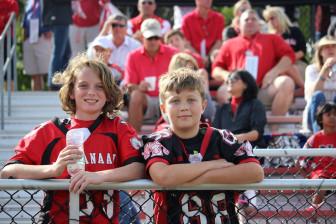 Future Ram Trey Hartnett (l) with a friend at a recent New Canaan High School football game. Credit: Terry Dinan