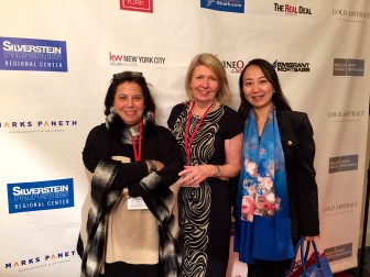 William Pitt New Canaan agents Leslie Razook and Inger Stringfellow with client Linda Xu. Contributed