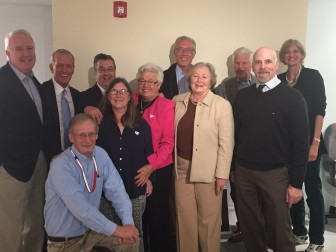 Town officials from both major parties gather at DTC headquarters on Main Street on Election Night, 2015. Standing, L-R: Paul Foley, Nick Williams, Rob Mallozzi, Chris Hussey, Roger Williams, Penny Young, Jim Kucharcyzk, Joe Paladino, Penny Rashin. Kneeling: Sven Englund. Beth Jones standing beside him. Contributed