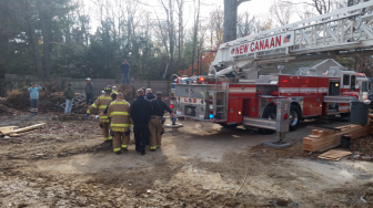 The victim is tended to by emergency responders following a Nov. 30, 2015 accident at 252 Carter St. Photo published with permission from its owner