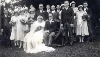 Rose and Leo Karl Sr. on their wedding day in 1925, two year before Leo founded Karl Chevrolet with his brother Emil. Standing behind Rose is Henry Kelley, her father. Photo courtesy of the Karl family