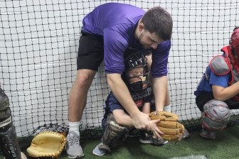 Former NCHS great Casey Ouellette helps out future NCHS great Maddox Hoffman at the NC Baseball clinic, Dec. 29, 2015. Credit: Terry Dinan