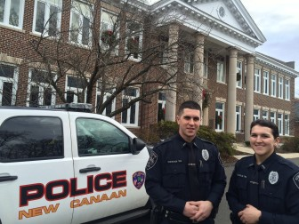 Officers Will Sheehan and Kelly Coughlin of the New Canaan Police Department on Dec. 18, 2015. Credit: Michael Dinan